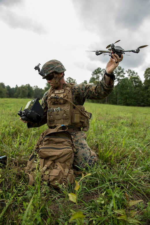 Marine with Company Bravo, 1st Battalion, 6th Marine Regiment, prepares to fly an InstantEye Mk-2 during Infantry Platoon Battle Course as part of Deployment for Training on Fort Pickett, Virginia, August 15, 2017 (U.S. Marine Corps/Michaela R. Gregory)