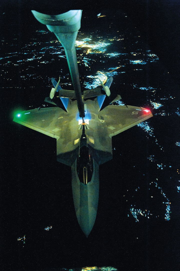 Air Force KC-10 Extender aircraft refuels F-22 Raptor aircraft over undisclosed location, September 26, 2014, before strike operations in Syria (DOD/Russ Scalf)