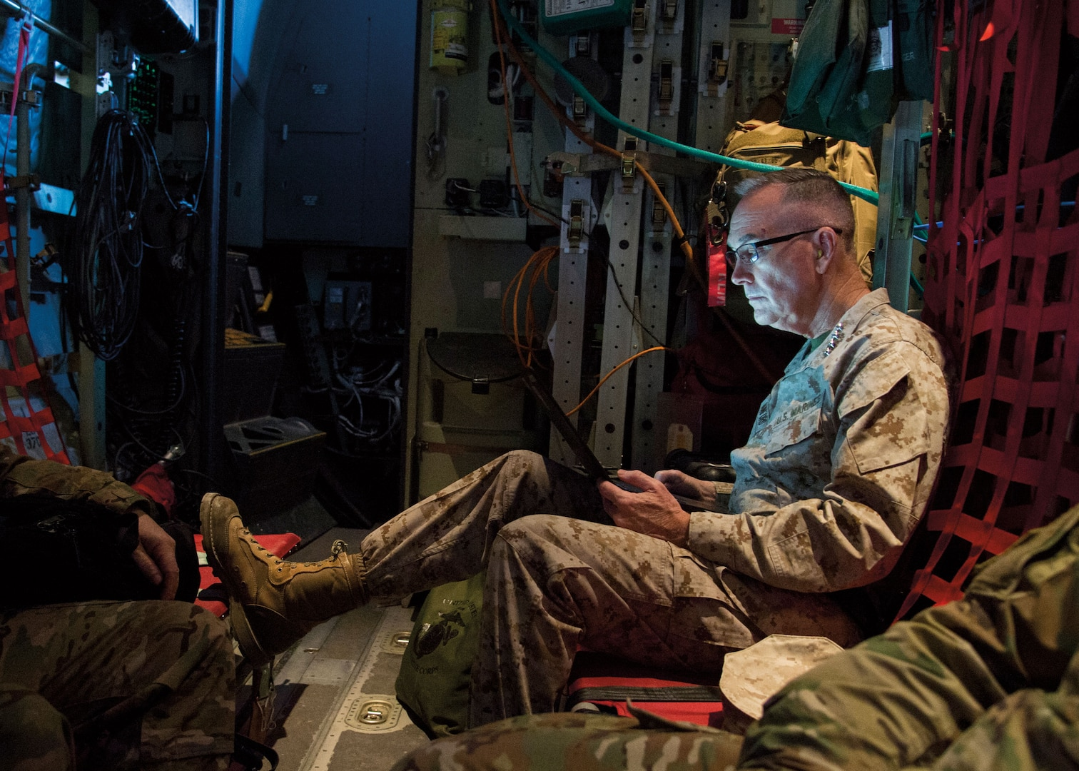 General Dunford works aboard C-130 aircraft at Bagram Airfield before visit to Task Force–Southwest at Camp Shorab, Helmand Province, March 22, 2018 (DOD/Dominique A. Pineiro)