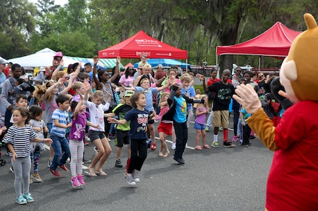 Kids participate in a dance party during Kids Fest in downtown Beaufort, April 7. April is Month of the Military Child and Child Abuse Prevention Month. Marine Corps Community Services hosted the event, organizing informational booths, resources and entertainment.
