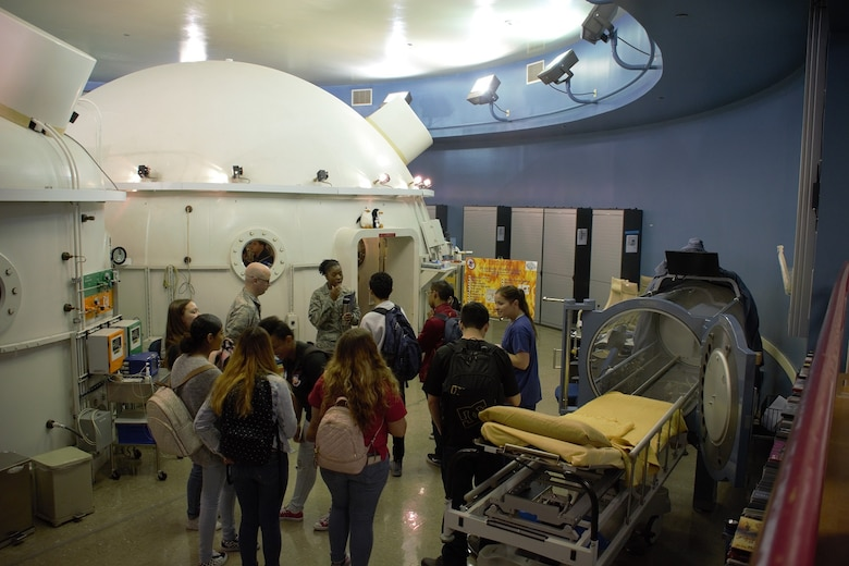 Students from De Anza High School tour the hyperbaric chamber at David Grant USAF Medical Center March 29 at Travis Air Force Base, Calif. The students attended the tour to have a work-based understanding of the workings of an operating hospital.