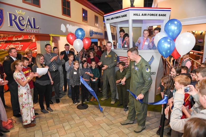 Col. Aaron Blum, 75th Air Base Wing, with Maj. Shayne Carroll, 4th Figher Squadron, cut the ceremonial ribbon during Junior Achievement City's grand opening of their model air traffic control tower April 10, 2018, in Salt Lake City. The tower was built courtesy of Hill Air Force Base. The JA City is an interactive learning environment where students learn about real-life careers. (U.S. Air Force photo by Cynthia Griggs)