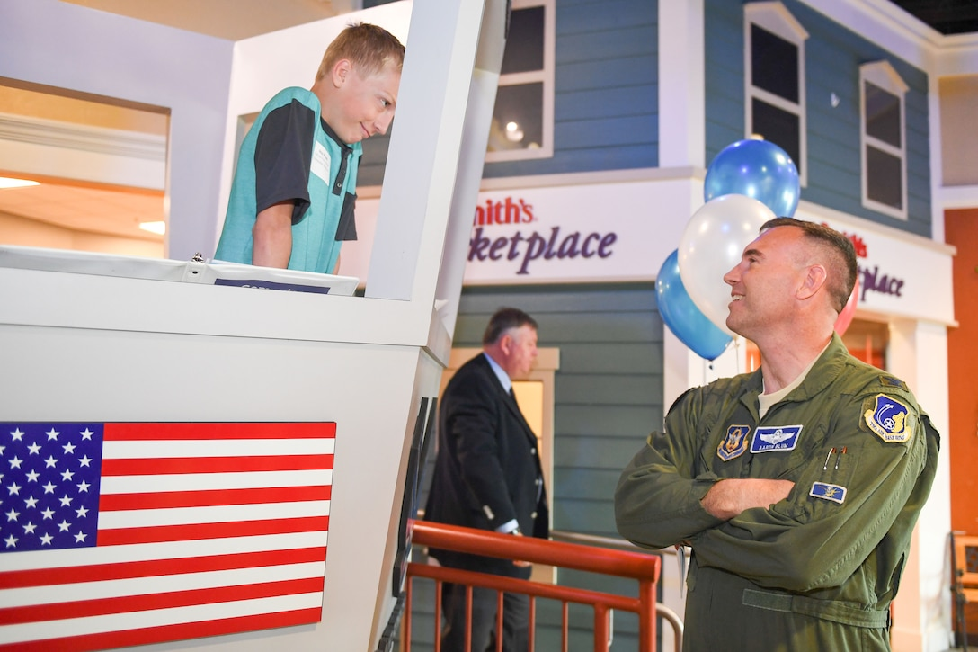 Col. Aaron Blum, 75th Air Base Wing, interacts with Skip Waugh, a 5th grader from Snow Horse Elementary in Kaysville, Utah, during the Junior Achievement City's grand opening of their model air traffic control tower in Salt Lake City. The tower was built courtesy of Hill Air Force Base. Junior Achievement City is an interactive learning environment where students learn about real-life careers. (U.S. Air Force photo by Cynthia Griggs)