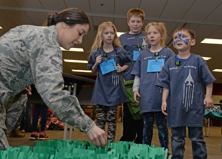 Children are given instructions for a game during a kids deployment line at Ellsworth Air Force Base, S.D., April 7, 2018.  One hundred children participated in the deployment line celebrating Month of the Military Child. (U.S. Air Force photo by Airman 1st Class Nicolas Z. Erwin)