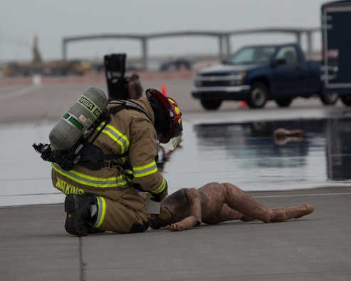 Tech. Sgt. Brent Watkins, 366th Civil Engineer Squadron firefighter tends to a simulated injury during an exercise April 5, 2018, at Mountain Home Air Force Base, Idaho. The Major Accident Response Exercise tested first responders on dealing with a downed aircraft and securing large numbers of people. (U.S. Air Force photo by Airman 1st Class Jeremy D. Wolff)