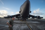 General Dunford walks past B-52 aircraft during tour of Andersen Air Force Base, Guam, February 8, 2018 (DOD/Dominique A. Pineiro)