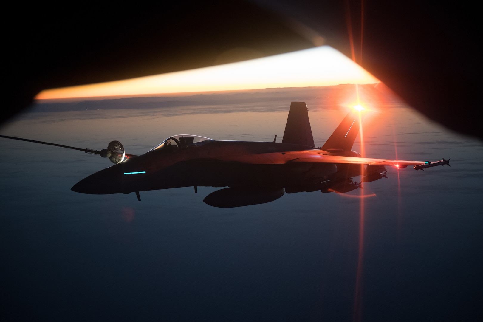 KC-135 Stratotanker assigned to 340th Expeditionary Air Refueling Squadron, Al Udeid Air Base, Qatar, refuels Navy F/A-18E/F Super Hornet assigned to USS Theodore Roosevelt, performing precision airstrikes against six Taliban narcotic targets in Helmand Province, Afghanistan, December 7, 2017 (U.S. Air Force/Jeff Parkinson)