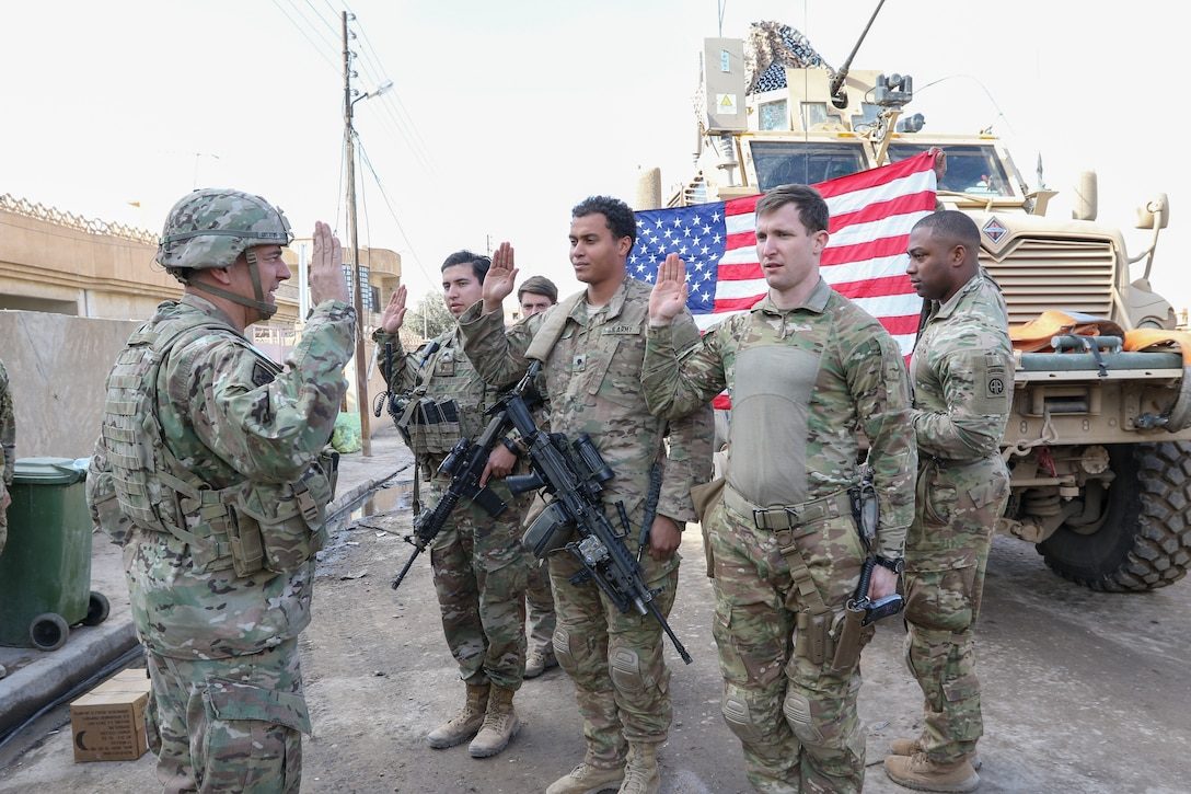 Commander of Combined Joint Task Force–Operation Inherent Resolve and XVIII Airborne Corps reenlists paratroopers of 2nd Battalion, 325th Airborne Infantry Regiment, 2nd Brigade Combat Team, 82nd Airborne Division, near Bartallah, Iraq, February 1, 2017 (U.S. Army/Loni Ayers)