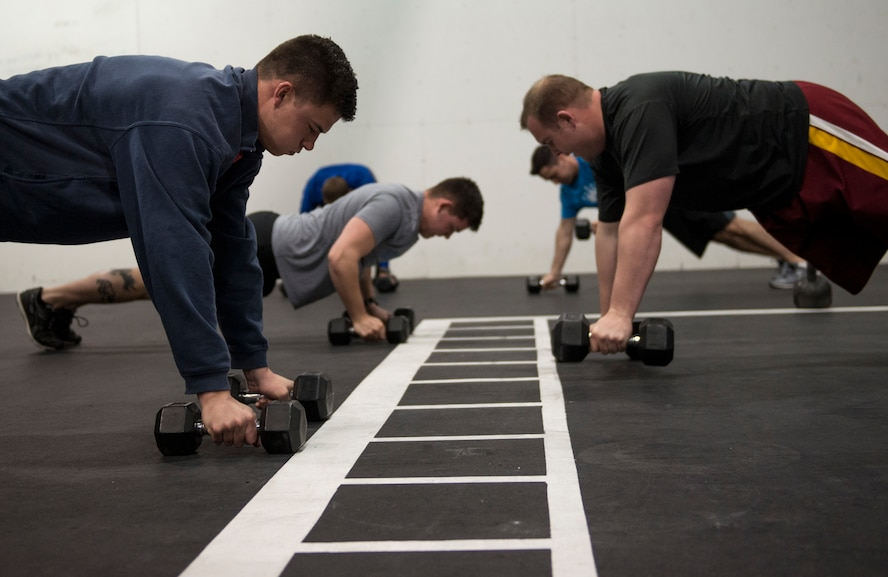 Initial Qualification Course student pilots assigned to the 310th Fighter Squadron perform a group exercise at Luke Air Force Base, Ariz., Feb. 6, 2018. Luke medical professionals from the Human Performance Team will use equipment like stationary bikes, row machines, and dumb bells to develop physical fitness solutions for the highly active work and lifestyles of Airmen. (U.S. Air Force photo by Airman 1st Class Alexander Cook)