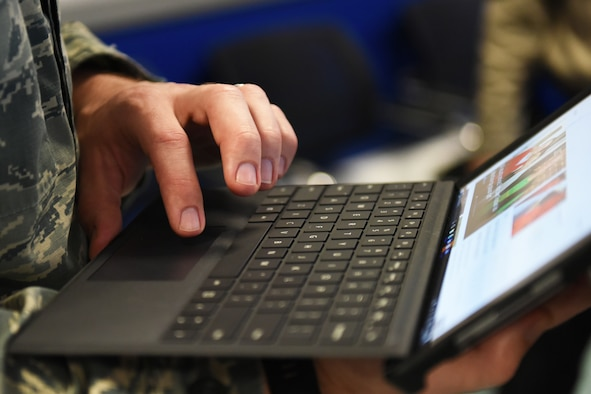 Technical Sgt. Troy M. Rivers, 48th Comptroller Squadron financial operations flight chief, uses a tablet to remotely access financial files at Royal Air Force Lakenheath, England, April 5, 2018. Royal Air Force Lakenheath is the first base in U.S. Air Forces in Europe to provide on-site financial customer service to their squadrons. (U.S. Air Force photo/Airman 1st Class Christopher S. Sparks)