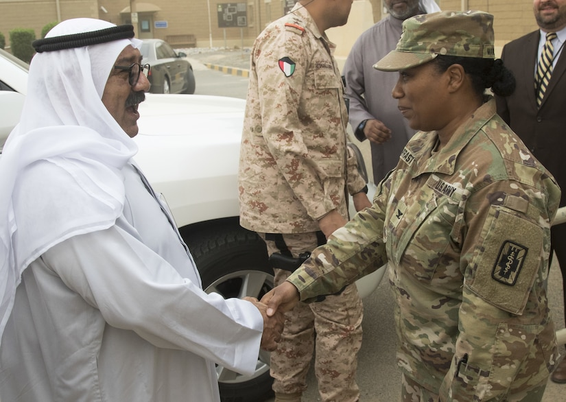 Col. Jennifer Marrast-Host, commander of the Combat Support Hospital, greets Shaykh Nasser,  First Deputy Prime Minister and Minister of Defense Kuwait, before giving him a tour of the troop medical clinic at Camp Arifjan, Kuwait, April 11, 2018. The minister toured three key points in the facility that demonstrated the hospital's range of medical capabilities.