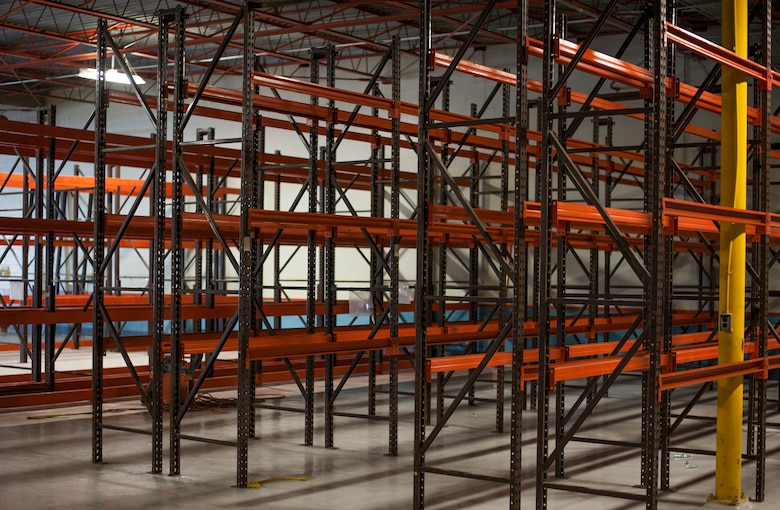 Shelving units remain empty prior to assembly inside the 6th Logistics Readiness Squadron warehouse at MacDill Air Force Base, Fla., April 11, 2018.