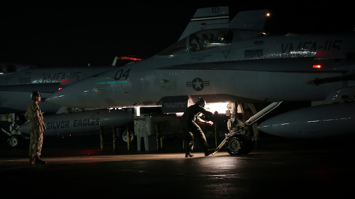 Maintainers prepare an F/A-18C Hornet for takeoff aboard Marine Corps Air Station Beaufort, April 9. The Hornet is with Marine Fighter Attack Squadron 115 and deployed in support of combat operation overseas. While deployed, the squadron will coordinate with our international partners and other branches of the U.S. military in order to ensure the mission is accomplished and freedom is protected.