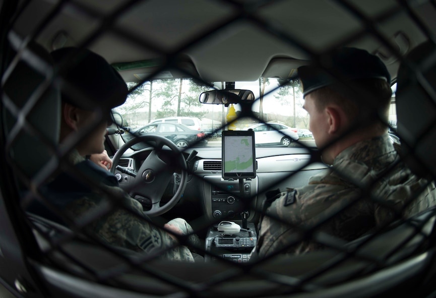 U.S. Air Force Staff Sgt. Ian Metcalf, left, and Senior Airman Nicholas Miller, 569th United States Forces Police Squadron desk patrolmen, use a tablet and satellite tracking application to locate other patrolmen on Vogelweh Military Complex, Germany, March 9, 2018. The 569th USFPS uses tablets installed with three applications to locate the nearest patrolman to an incident and notify them, cutting response time. That saves money, hours, and, most importantly, lives. (U.S. Air Force photo by Senior Airman Elizabeth Baker)