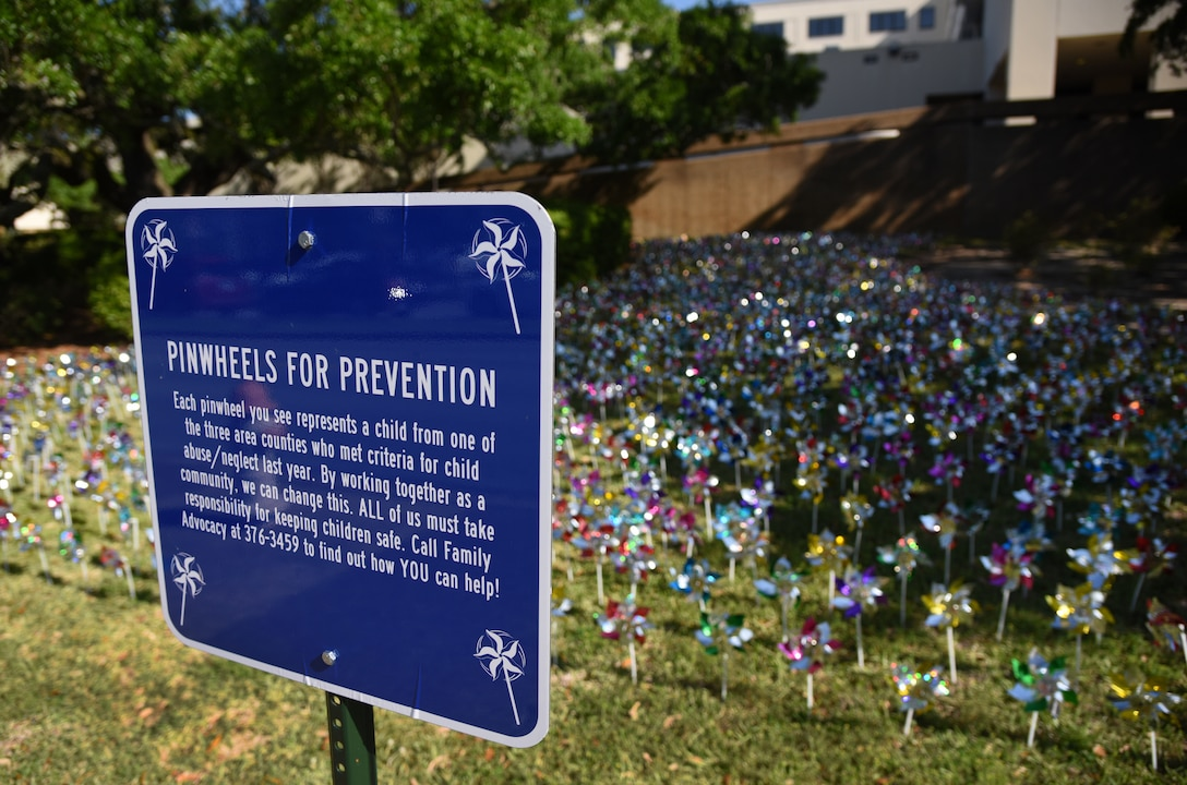 Pinwheels are displayed in front of the Keesler Medical Center at Keesler Air Force Base, Mississippi, April 11, 2018. Members of the 81st Medical Operations Squadron family advocacy and volunteers placed pinwheels to individually represent children in the three area counties who were victims of child abuse or neglect last year. April is National Child Abuse Prevention Month, which focuses on how to prevent child abuse and neglect as well as promoting child and family well-being. (U.S. Air Force photo by Kemberly Groue)