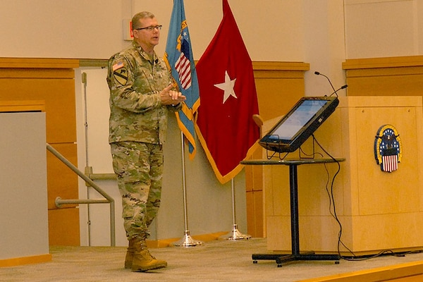 Army Brig. Gen. Mark Simerly, DLA Troop Support commander, addresses his workforce during a town hall event April 5. Simerly compared his employees to the reigning Super Bowl champion Philadelphia Eagles, citing their smarts, toughness and ability to come through in the clutch.
