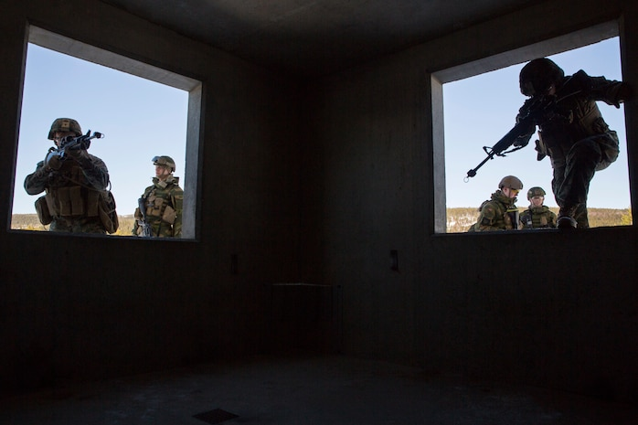 Marines with Marine Rotational Force-Europe 18.1 complete a Norwegian room-clearing technique during close-quarters combat training at Leksdal Skytefelt Training Complex, Norway, March 27, 2018. The law enforcement Marines integrated with Norwegian Home Guard 12 to learn new breaching and clearing tactics. The event is one of many training evolutions the Marines plan to execute with their NATO Allies, enhancing strategic cooperation and partnership between the U.S. and Norway.