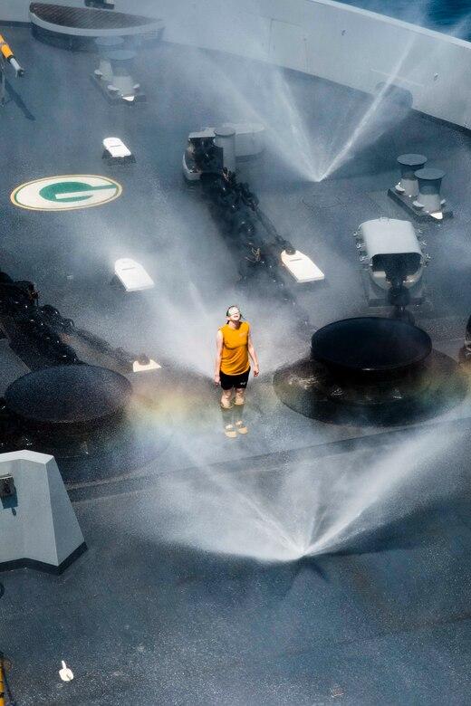 Damage Controlman tests countermeasure wash-down system on forecastle aboard USS Green Bay, Gulf of Thailand, February 9, 2017 (U.S. Navy/Chris Williamson)
