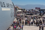 Members of the Chilean public walk through the airshow fairgrounds during the FIDAE 2018 international airshow in Santiago, Chile, April 8, 2018.  U.S. airmen participated in a variety of activities during the air show, including subject matter exchanges with the Chilean Air Force, aerial demonstrations, and interaction with the local community.  (U.S. Air Force photo by Staff Sgt. Danny Rangel)