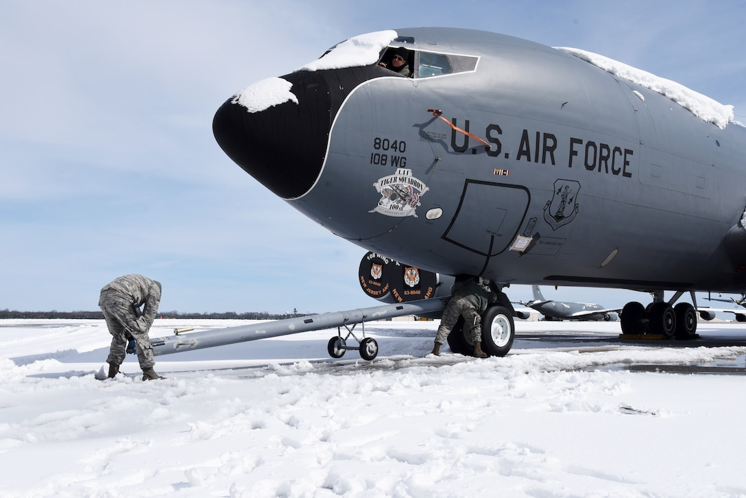 Airmen from the 108th Maintenance Group hook up a KC-135R Stratotanker to a truck on the 108th Wing's flightline at Joint Base McGuire-Dix-Lakehurst, N.J., March 22, 2018. The planes were moved out of the way in order to remove the snow from the flightline. (U.S. Air National Guard photo by Senior Airman Julia Santiago/Released)