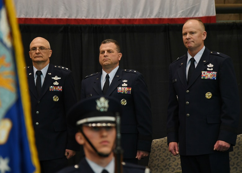 Brig. Gen. Michael Schmidt, right, takes leadership of the Command, Control, Communications, Intelligence and Networks directorate at Hanscom Air Force Base, Mass., April 13, 2018 from Maj. Gen. Dwyer Dennis, center, who is retiring, during a ceremony at hosted by Lt. Gen. Arnold Bunch, left, military deputy of the Office of Assistant Secretary of Air Force for Acquisition at the Pentagon. The change of leadership ceremony was held at the Hanscom Aero Club hangar.  (U.S. Air Force Photo by Linda LaBonte Britt)
