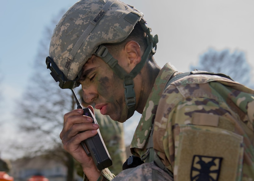U.S. Army Spc. Nicholas J. Sobel, 567th Inland Cargo Transportation Company, 53rd Battalion, 7th Transportation Brigade (Expeditionary) cargo specialist, talks over a radio Soldiers at Joint Base Langley-Eustis, Virginia., April 10, 2018. Soldiers tested their communication skills during the NCO of the Year and Soldier of the Year competition (U.S. Air Force photo by Airman 1st Class Monica Roybal)