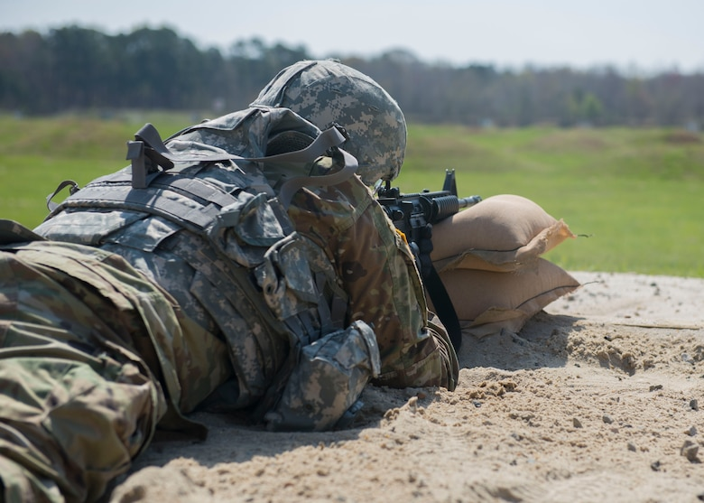 A U.S. Army Soldier fires an M-16 rifle at Joint Base Langley-Eustis, Virginia., April 11, 2018. Soldiers competing in the NCO of the Year and Soldier of the Year Competition were required to shoot at targets from various positions during this exercise. (U.S. Air Force photo by Airman 1st Class Monica Roybal)
