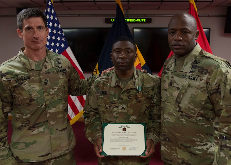U.S. Army Col. Richard D. Heyward, Center for Initial Military Training deputy commander, U.S. Army Sgt. Tiphine T. Tobo, Headquarters and Headquarters Detachment 10th Battalion, 7th Transportations Brigade (Expeditionary) battalion school NCO in charge, and U.S. Army Command Sgt. Maj. Edward W. Mitchell, Center for Initial Military Training command sergeant major, display the brigade-level NCO of the Year certificate at Joint Base Langley-Eustis, Virginia., April 12, 2018. Tobo was named the brigade-level NCO of the Year (U.S. Air Force photo by Airman 1st Class Monica Roybal)