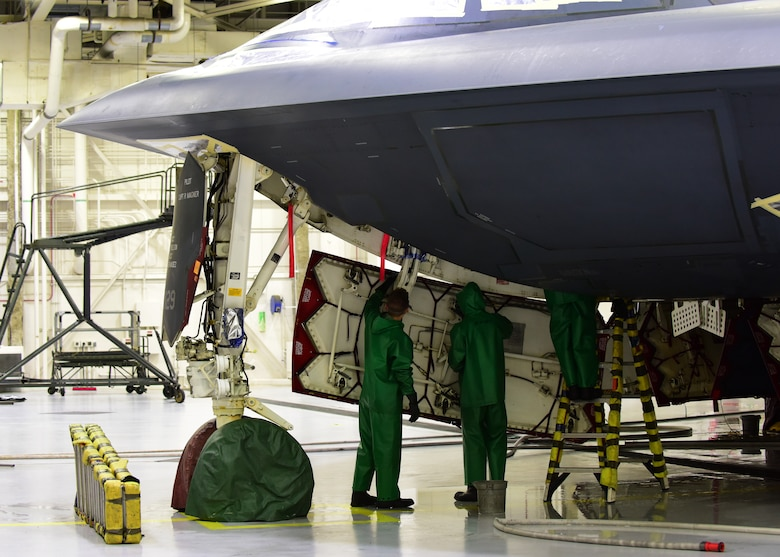 Crew chiefs assigned to the 509th Aircraft Maintenance Squadron finish wiping down the inside of a panel of a B-2 Spirit during a wash at Whiteman Air Force Base, Mo., April 10, 2018. Each square inch of the B-2 is carefully inspected while a wash is being conducted to ensure the aircraft is mission ready once it is completely cleaned. (U.S. Air Force photo by Staff Sgt. Danielle Quilla)