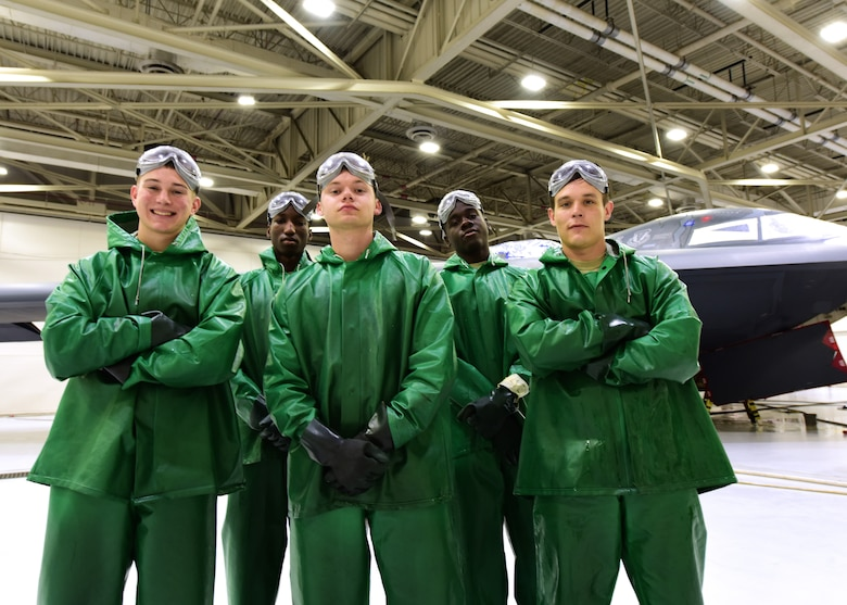 Members of the 509th Aircraft Maintenance Squadron, wear special gear while washing B-2 Spirits at Whiteman Air Force Base, Mo., April 10, 2018. The cleaning chemicals are stronger than the typical soaps used to wash equipment so the green suits, black rubber gloves and goggles protect the Airmen. (U.S. Air Force photo by Staff Sgt. Danielle Quilla)