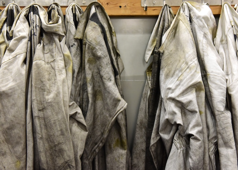 Coveralls hang ready to be checked out by crew chiefs stationed at Whiteman Air Force Base, Mo., April 10, 2018. The white coveralls are used to help protect the Airmen from the different chemicals they use while performing maintenance on B-2 Spirits (U.S. Air Force photo by Staff Sgt. Danielle Quilla)