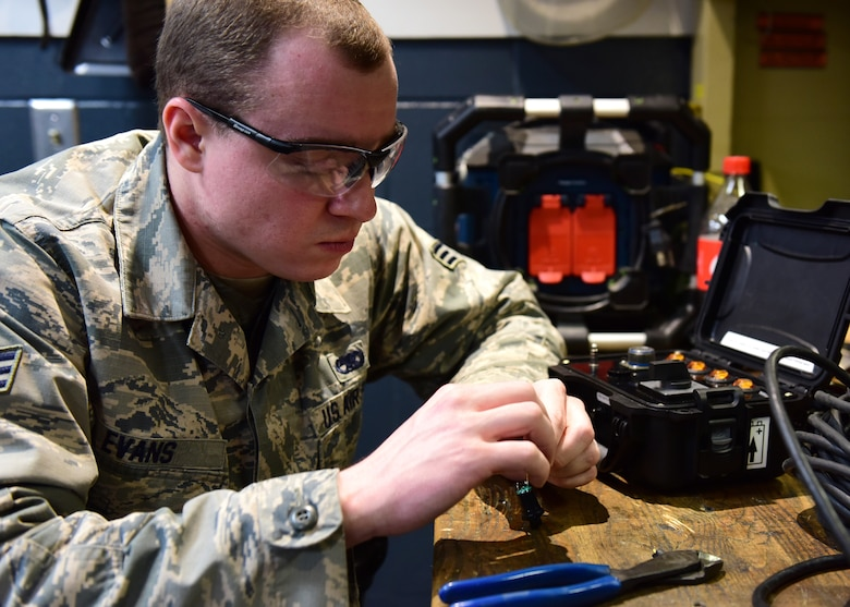 U.S. Air Force Senior Airman Cody Evans, a composite tool kit technician assigned to the 509th Aircraft Maintenance Squadron, fixes communication equipment at Whiteman Air Force Base, Mo., April 10, 2018. The members of the 509th AMXS are responsible for day-to-day maintenance of the B-2 Spirit. (U.S. Air Force photo by Staff Sgt. Danielle Quilla)