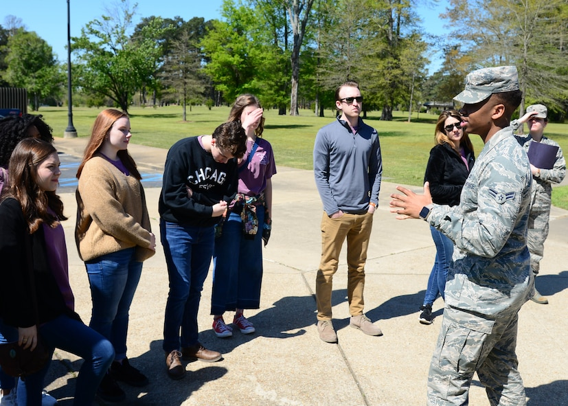 Airman 1st Class Rodney Williams, 14th Operations Support Squadron aviation resource manager, greets the Lowndes Young Leaders during a base tour April 10, 2018, on Columbus Air Force Base, Mississippi. Lowndes Young Leaders is a 12-month leadership program for high school sophomores that live in and attend high school or are homeschooled in Lowndes County, Mississippi. (U.S. Air Force photo by Airman 1st Class Beaux Hebert)