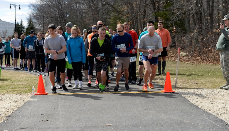 Participants in the Sexual Assault Awareness Month 5K run take off from the starting line on April 08, 2018 at Pease Air National Guard Base, N.H. The Sexual Assault Prevention Response Team hosts the annual event. (N.H. Air National Guard photo by Airman 1st Class Victoria Nelson)