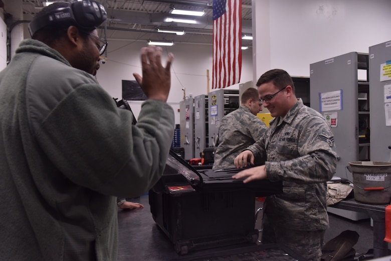 U.S. Air Force Senior Airman Daniel Meehan, a composite tool kit technician assigned to the 509th Aircraft Maintenance Squadron, helps a crew chief check out maintenance tools at Whiteman Air Force Base, Mo., April 10, 2018. In the supply building, the technicians control more than $15 million worth of equipment. (U.S. Air Force photo by Senior Airman Jovan Banks)