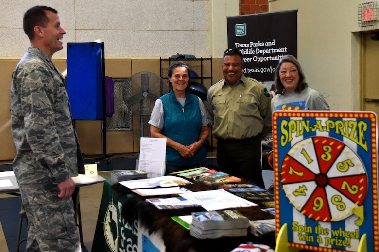 U.S. Air Force Col. Jeffrey Sorrell, 17th Training Wing vice commander, talks with venders at the Volunteer Fair held at Carswell Field House on Goodfellow Air Force Base, Texas, April 11, 2018. Venders from non-profit organizations were able to come and set up booths raising awareness for various volunteer opportunities available to Goodfellow members. (U.S. Air Force photo by Airman 1st Class Seraiah Hines/Released)