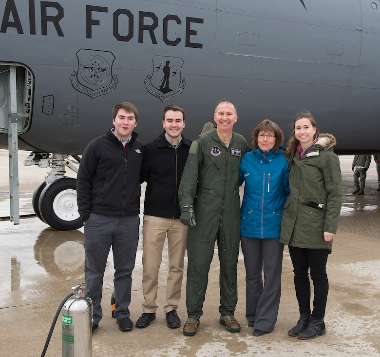 Col. James P. Ryan, retired 157th Air Refueling Wing commander, poses for a photo with his wife and their three children on Feb. 23, 2018, at Pease Air National Guard Base, N.H. Ryan's family was present for his fini-flight, or final flight, as a member of the N.H. Air National Guard. (N.H. Air National Guard photo by Staff Sgt. Kayla White)