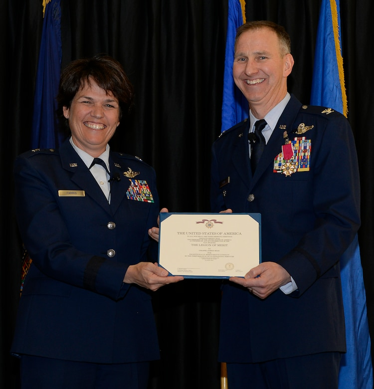 Col. James P. Ryan, retired 157th Air Refueling Wing commander, receives a Legion of Merit certificate from Brig. Gen. Laurie M. Farris, commander of the N.H. Air National Guard, on April 07, 2018 at Pease Air National Guard Base, N.H. Ryan retired after more than 30 years of service. (N.H. Air National Guard photo by Airman 1st Class Victoria Nelson)