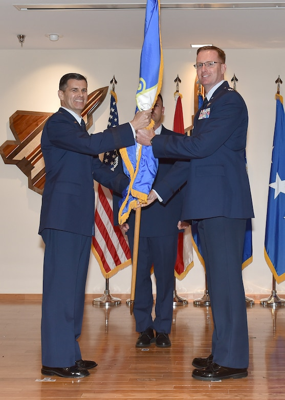 Col. Greg Krane, Continental U.S. NORAD Region – First Air Force (Air Forces Northern) deputy chief of staff, takes the ceremonial flag from Brig. Gen. Brian Simpler, Florida Air National Guard commander, during the 101st Air and Space Operations Group change of command ceremony at Tyndall Air Force Base, Florida on April 13, 2018.