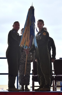 U.S. Air Force Col. Brian Gallo, the 509th Operations Group commander, passes the guidon to Lt. Col. Geoffrey Steeves, as Steeves assumes command of the 13th Bomb Squadron,  at Whiteman Air Force Base, Mo., April 13, 2018. The 394th Combat Training Squadron was inactivated and its personnel shifted over to the 13th Bomb Squadron, which will now serve as the formal training unit for the B-2 Spirit.