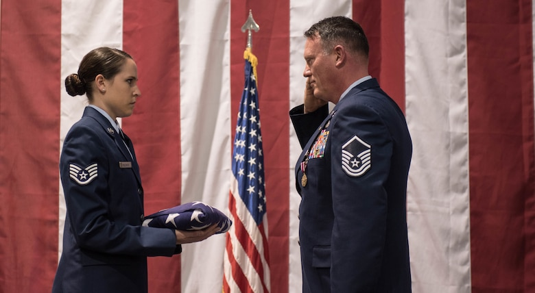 After 32 years of service, Master Sgt. Rodney Huffer, 921st Contingency Response Squadron, salutes an American Flag during a retirement ceremony at Travis Air Force Base, Calif. During Huffer career he has served on active duty, Air Force Reserves and the Air National Guard. (U.S. Air Force photo/Staff Sgt. Robert Hicks)