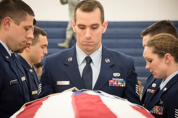 Members of the Wright Patterson Air Force Base Honor Guard graduated 10 new members from the Ohio Air National Guard and Air Force Reserve March 23, 2018 at the 200th RED HORSE Squadron, Camp Perry, Ohio. The members went through a one week training to be able to perform military funeral honors in support of the Wright Patterson Air Force Base Honor Guard.(U.S. Air National Guard photo by Capt. Paul Stennett/Released)