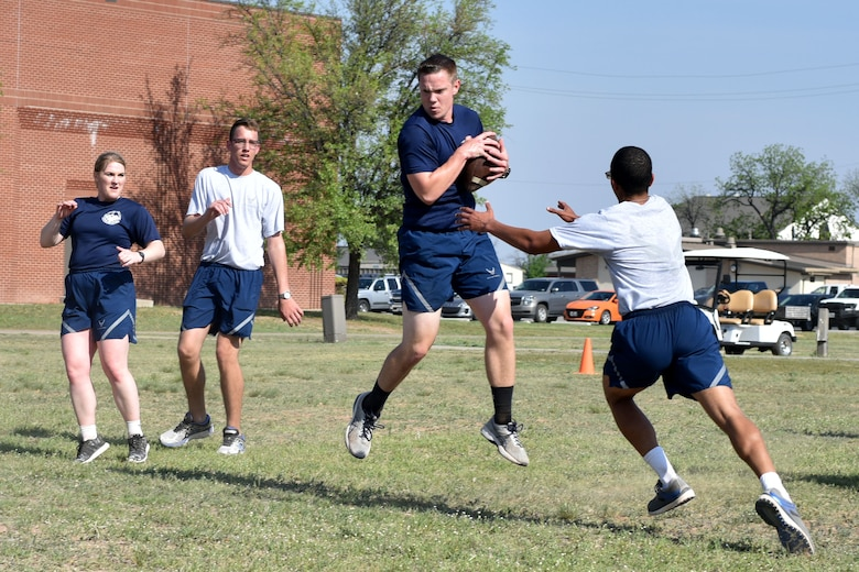 Goodfellow airmen play touch football during Sports Day at the Mathis Fitness Center on Goodfellow Air Force Base, Texas, April 13, 2018. Teams competed to earn points for their units in an attempt to win the trophy.