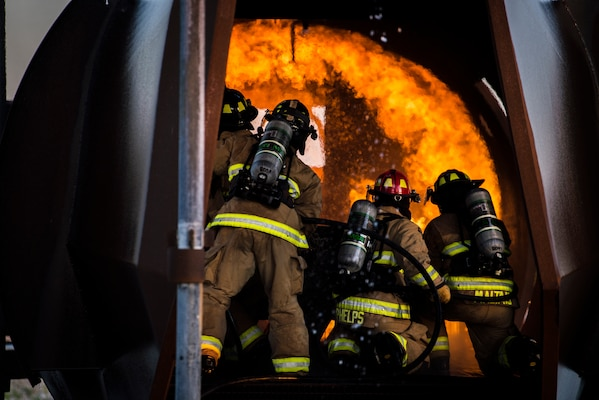 Firefighters from Joint Base San Antonio-Randolph extinguish a fire during training April 11, 2018 at the Camp Talon fire training grounds on JBSA-Randolph. The training takes place quarterly and offers an opportunity for new firefighters to become more confident while fighting fires, but it also gives seasoned Airmen a chance to sharpen their skills and get a head start to the next step in their careers. (U.S. Air Force photo by Senior Airman Gwendalyn Smith)