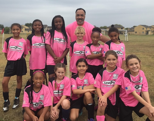 Scott Lee Denson, a volunteer youth coach for Joint Base San Antonio with Team Awesome after a soccer game, November 4, 2017. Denson volunteers to coach his daughter and a team of nine and ten year old girls throughout JBSA through the Alamo Heights Fort Sam Houston Soccer Club.