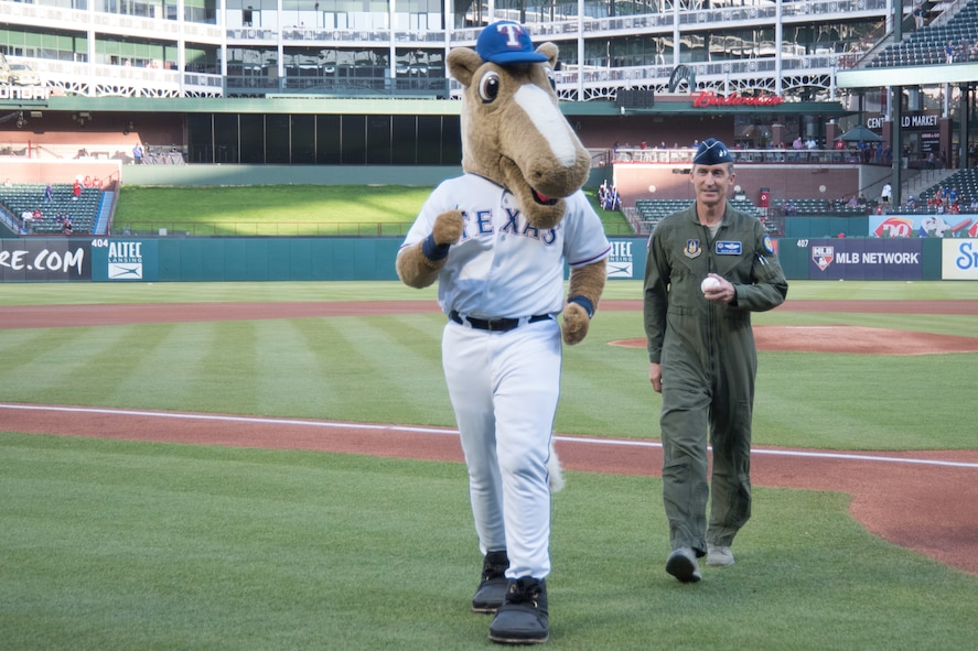 In celebration of Air Force Reserve's 70th Birthday, Maj. Gen. Ronald B. Miller threw out the first pitch at the Texas Rangers game against the Los Angeles Angels. The Dyess Air Force Base Honor Guard presented the colors for the game as well.