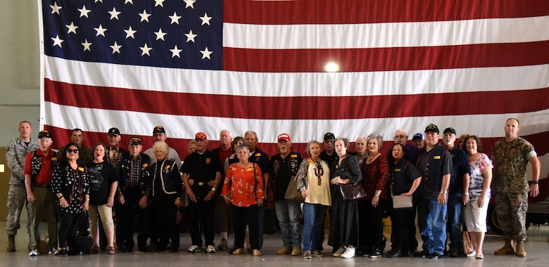 Members from the Texas chapter of the 3rd Marine Division Association and their tour guides finish off a tour with a singing of the Marine's Hymn at the Louis F. Garland Department of Defense Fire Academy on Goodfellow Air Force Base, Texas, April 13, 2018. The members were educated about the strenuous training that fire protection specialists receive while attending the fire academy at Goodfellow. (U.S. Air Force photo by Airman 1st Class Seraiah Hines/Released)