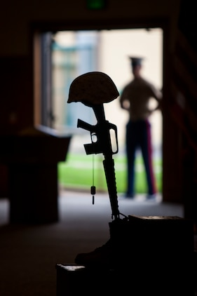 Military Battle Cross is displayed for fallen U.S. Marine