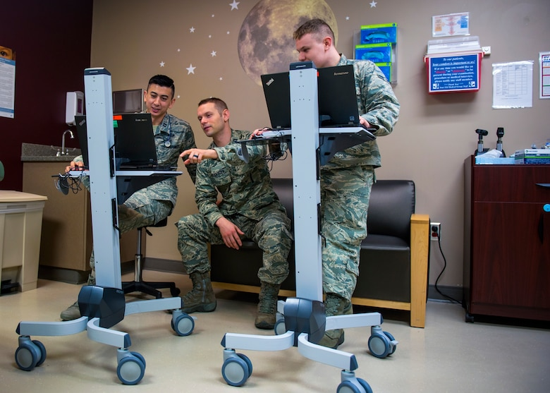 (from left) Capt. Joseph Migliuri, 92nd Medical Group pediatrician, Capt. Neal Alexander, 92nd MDG maternal child flight nurse manager, and Airman 1st Class Levi Brown, 92nd MDG aerospace medical technician, review patient medical records prior to an appointment at Fairchild Air Force Base, Wash., April 4, 2018. The pediatric team has implemented a new concept of operations: rewarding, efficiency, setting priorities and empowering team members, or RESET, to their system of patient care. Virtual appointments are offered to allow patients to receive the care they need from doctors without having to visit the clinic and has also allowed doctors to have more time to see more patients per day (U.S. Air Force photo by Airman 1st Class Whitney Laine)