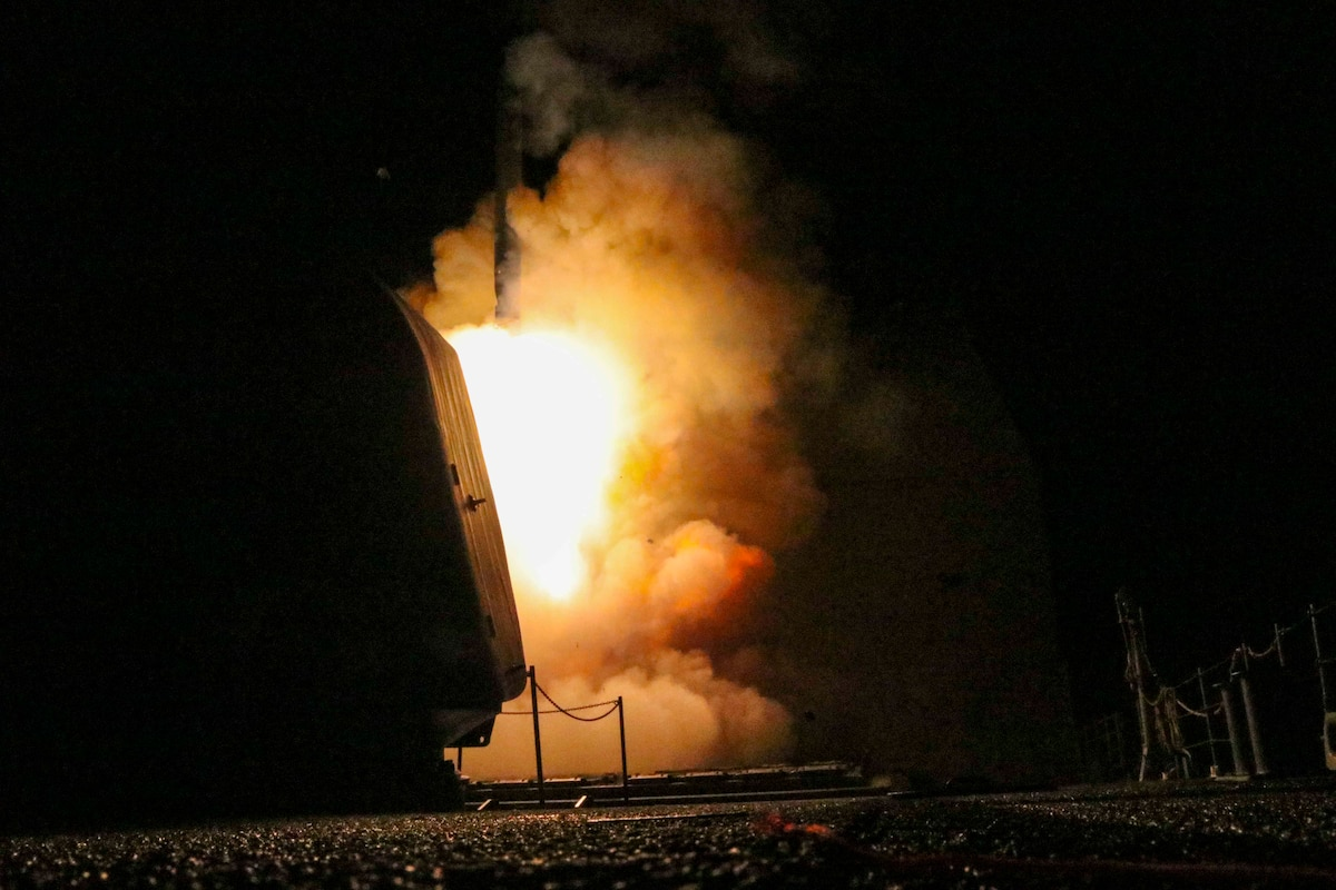 Flames erupt as a missile launches at night.